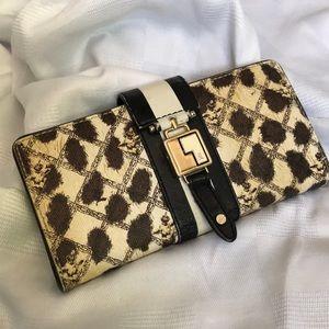 L.A.M.B. Cheetah wallet used